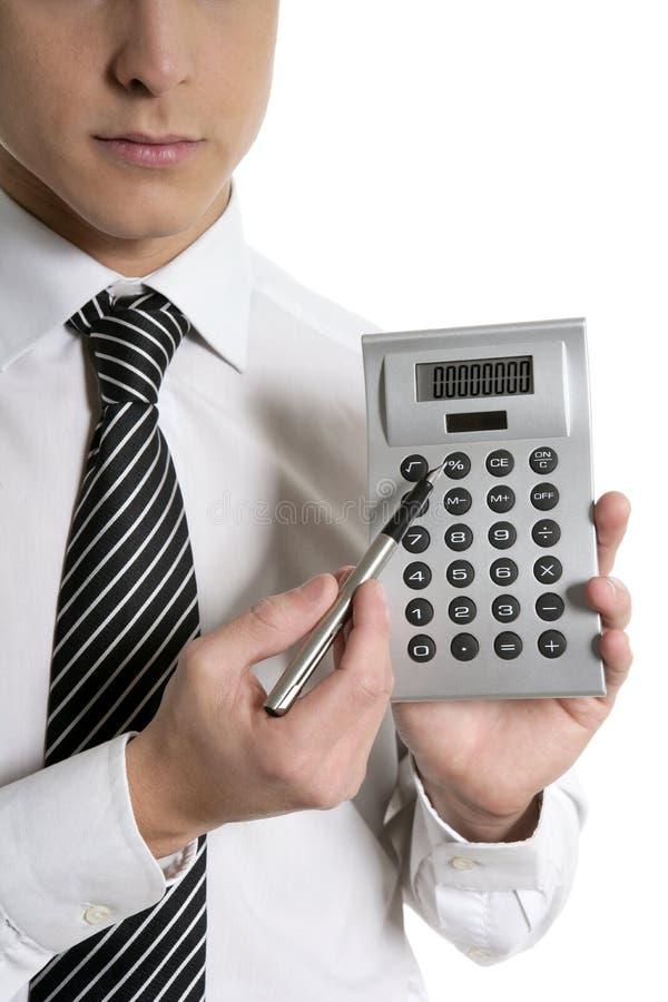 Homem de negócios com a calculadora que mostra relatórios imagem de stock