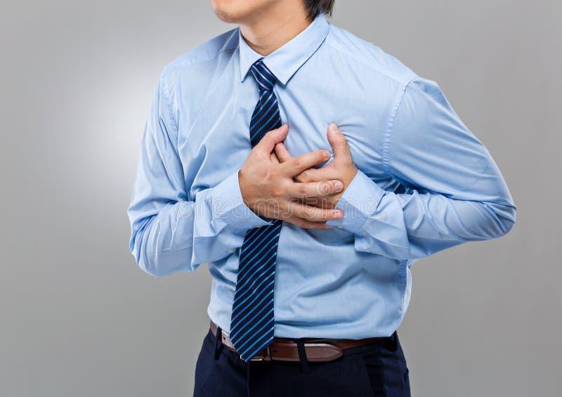 Homem de negócios com cardíaco de ataque imagem de stock royalty free