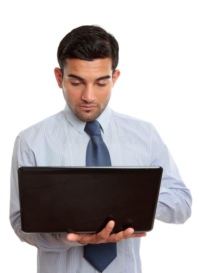 Homem de negócios com computador portátil imagens de stock royalty free