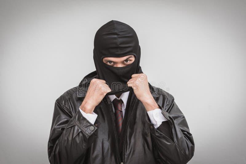 Homem de negócios com conceito da hipocrisia da máscara imagens de stock royalty free