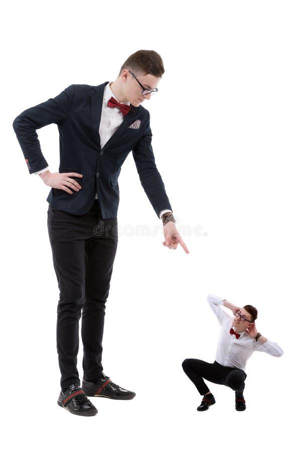 Homem de negócios com dedo que aponta para baixo para ele menos imagem de stock