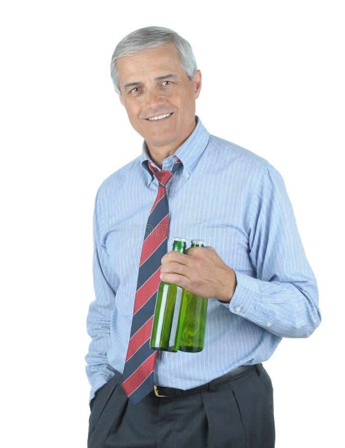 Homem de negócios com duas cervejas fotografia de stock royalty free