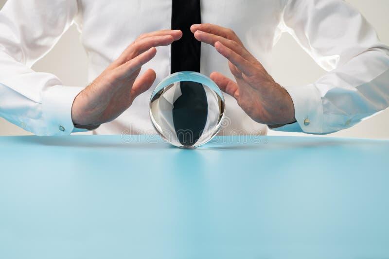 Homem de negócios com esfera de cristal fotos de stock