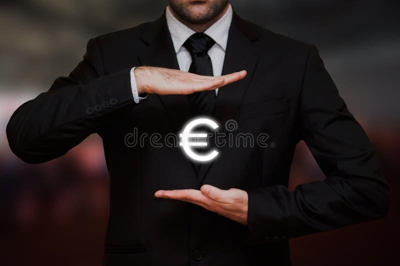 Homem de negócios com euro- símbolo fotos de stock royalty free