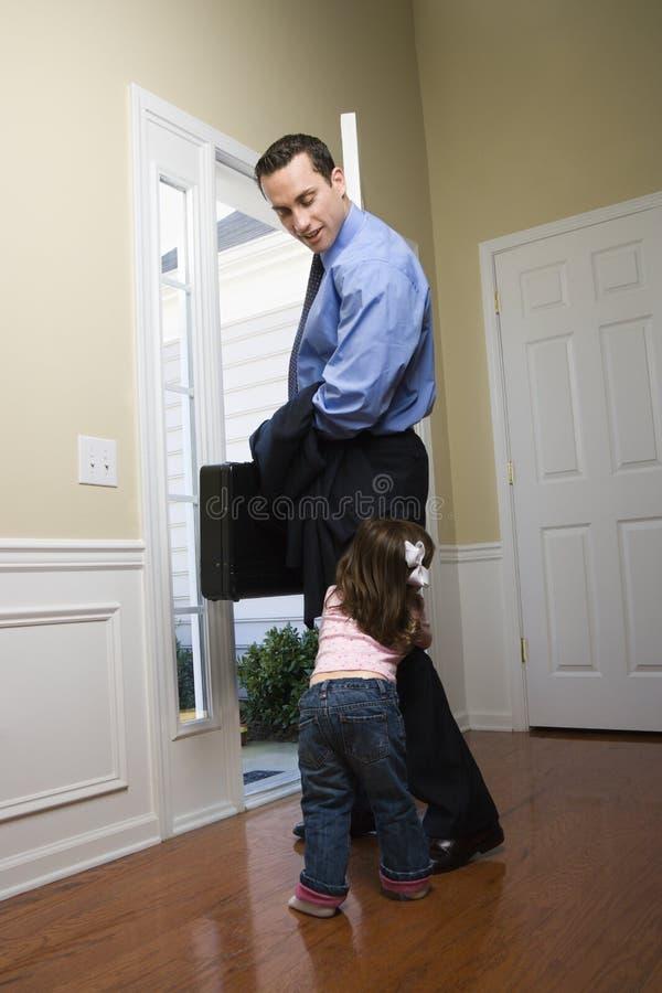 Homem de negócios com filha. fotografia de stock royalty free