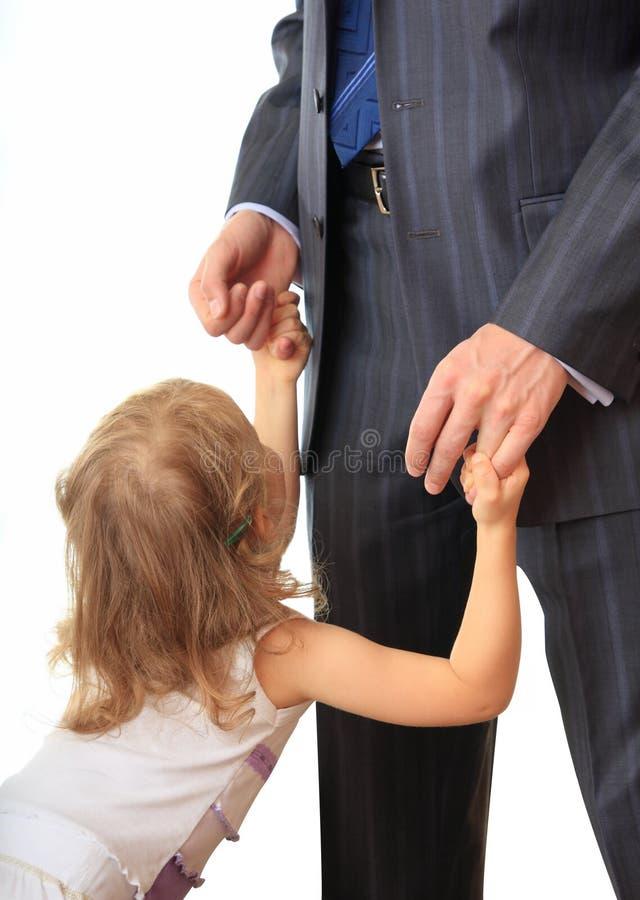 Homem de negócios com filha pequena. fotografia de stock royalty free