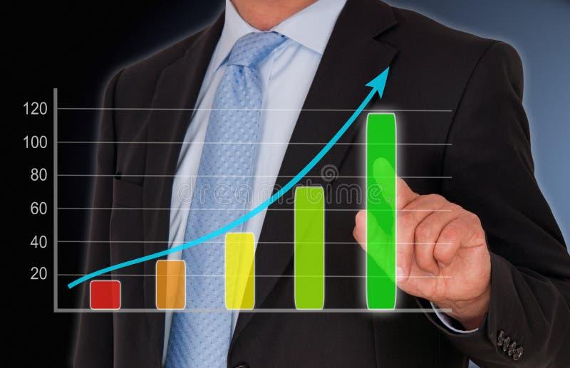 Homem de negócios com gráfico das vendas foto de stock royalty free