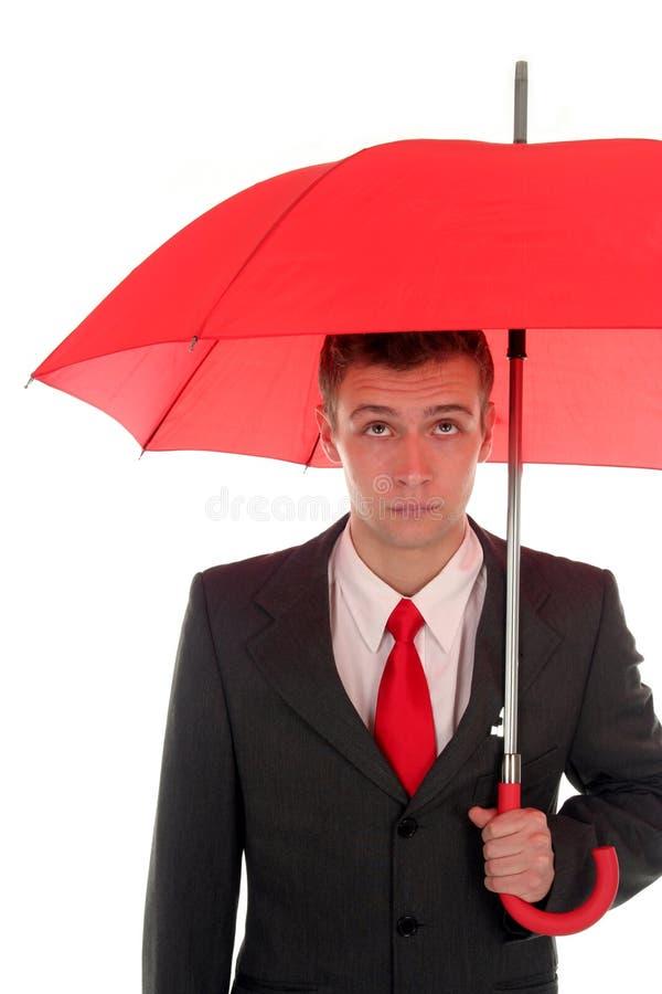 Homem de negócios com guarda-chuva imagem de stock