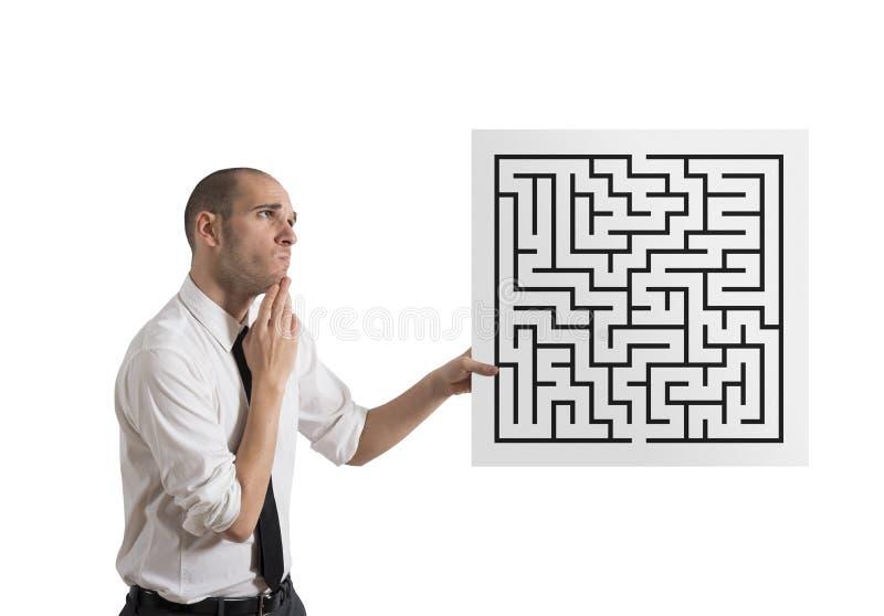 Homem de negócios com labirinto fotos de stock