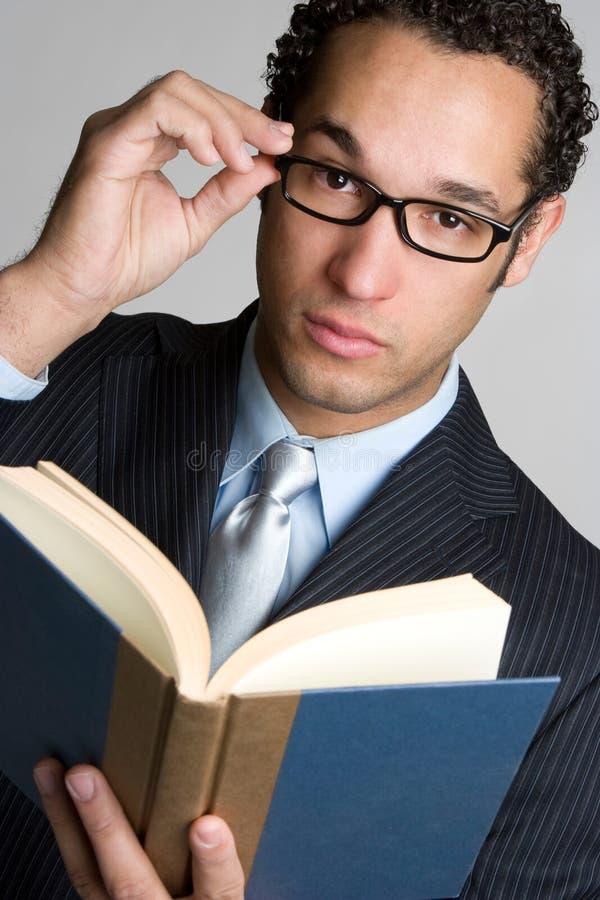 Homem de negócios com livro imagem de stock