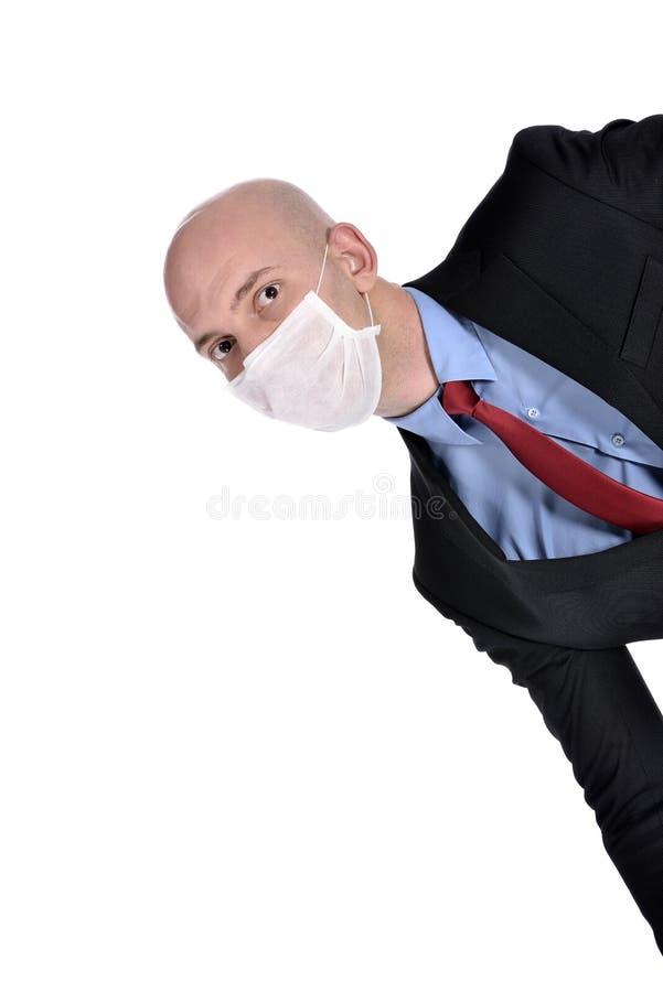 Homem de negócios com máscara contra a gripe de suínos fotos de stock