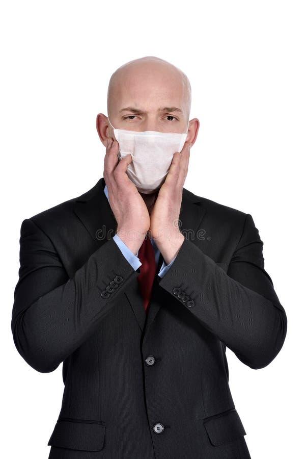 Homem de negócios com máscara contra a gripe de suínos fotos de stock royalty free
