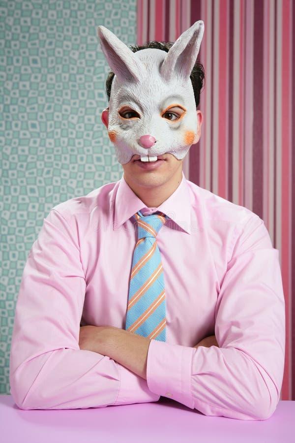 Homem de negócios com máscara engraçada do coelho fotos de stock royalty free