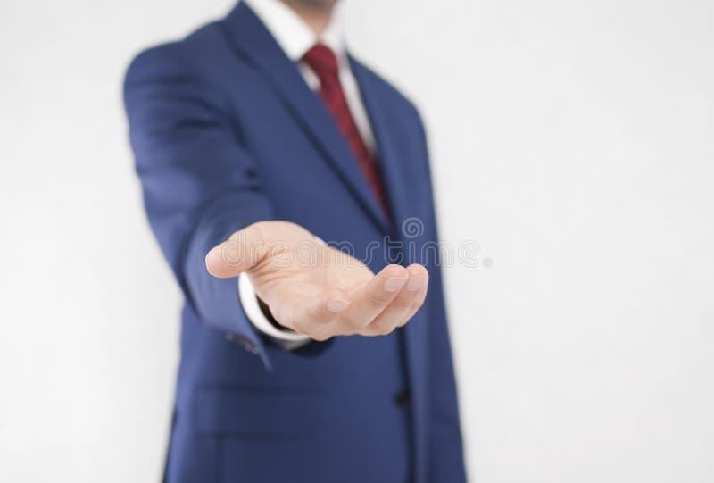 Homem de negócios com mão aberta imagem de stock