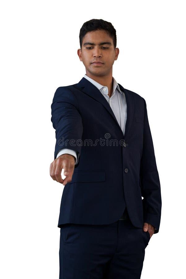Homem de negócios com mãos em relação invisível tocante dos bolsos imagem de stock royalty free