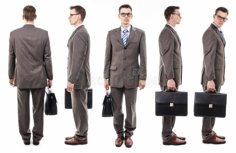 Homem de negócios com a mala de viagem de todos os lados fotografia de stock