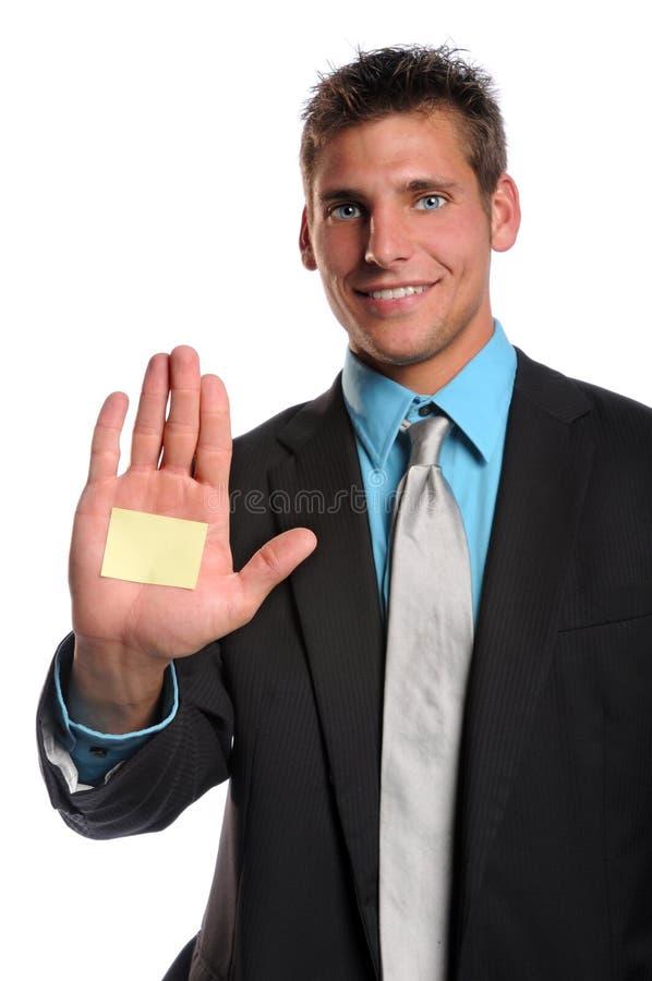 Homem de negócios com nota adesiva na mão imagens de stock