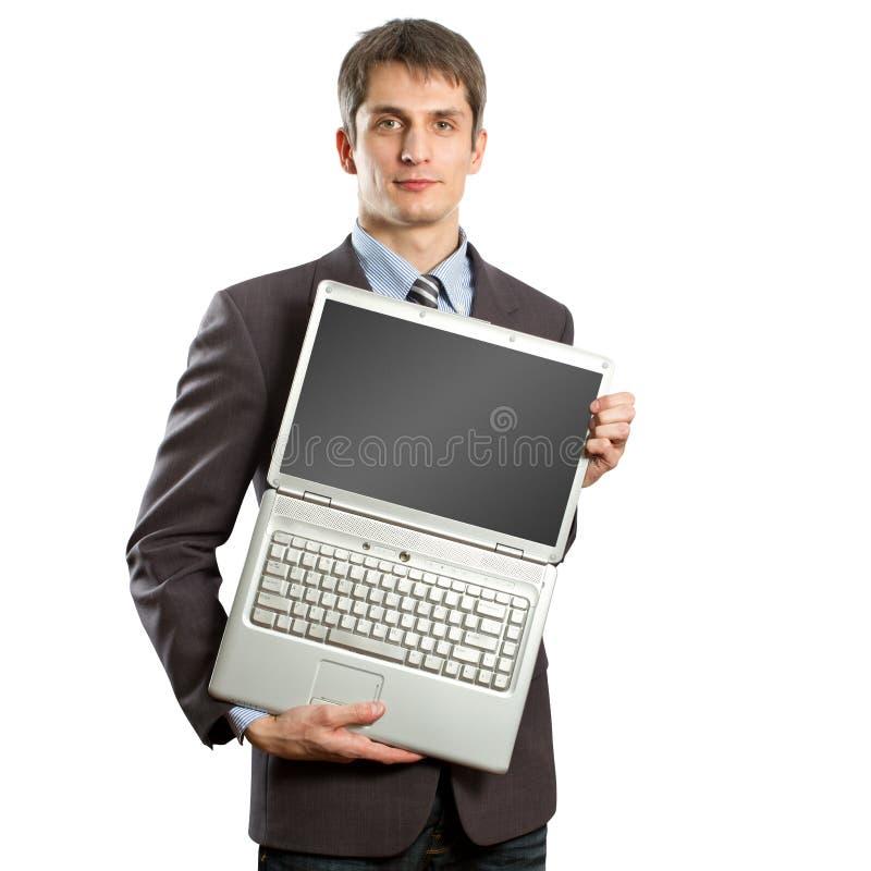 Homem de negócios com o portátil aberto em suas mãos fotos de stock royalty free
