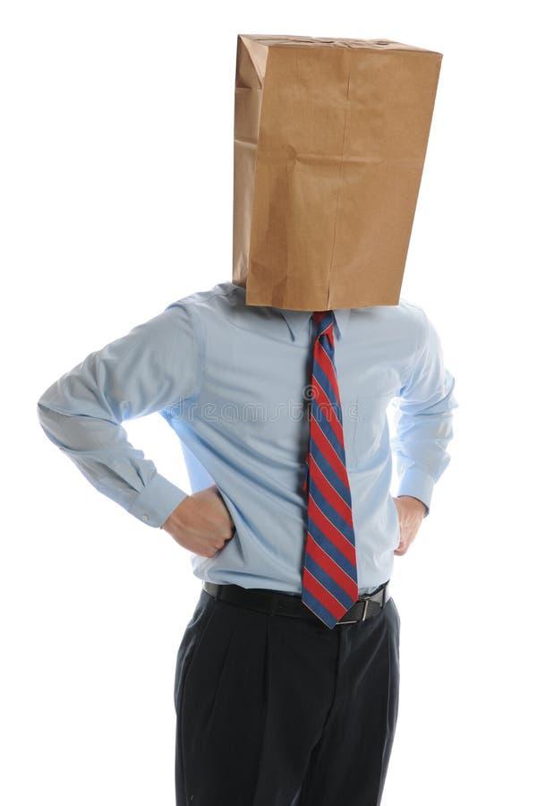 Homem de negócios com o saco de papel em sua cabeça imagens de stock royalty free