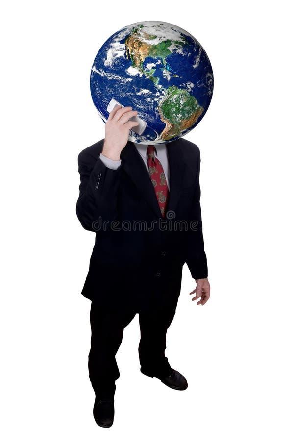 Homem de negócios com o telefone de pilha da terra arrendada da cabeça da terra fotos de stock royalty free