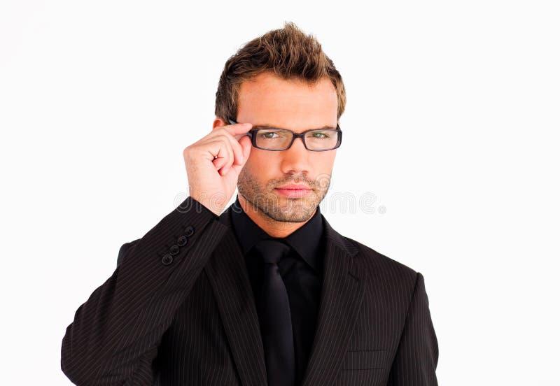 Homem de negócios com os vidros que olham a câmera imagens de stock