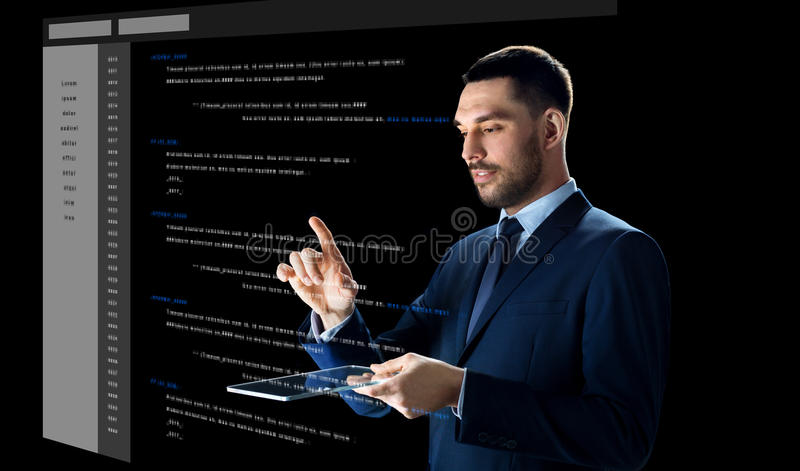 Homem de negócios com PC da tabuleta e codificação virtual foto de stock royalty free