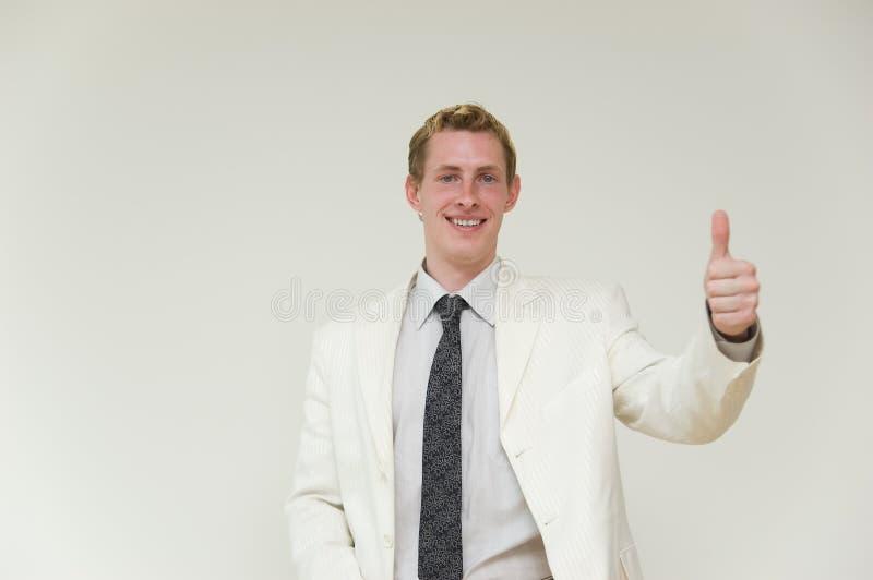 Homem de negócios com polegar acima sobre imagem de stock
