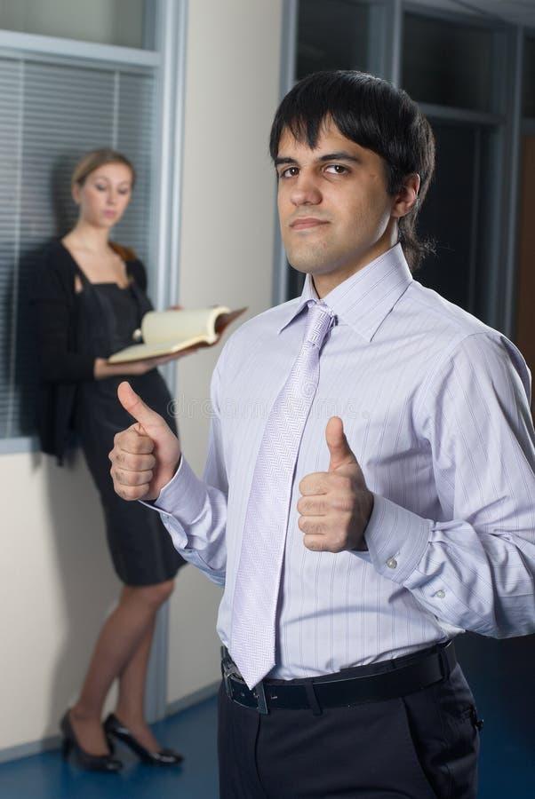 Homem de negócios com polegares acima fotografia de stock royalty free