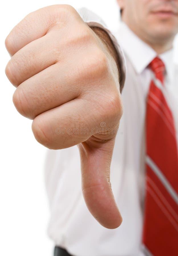Homem de negócios com polegares para baixo imagem de stock royalty free