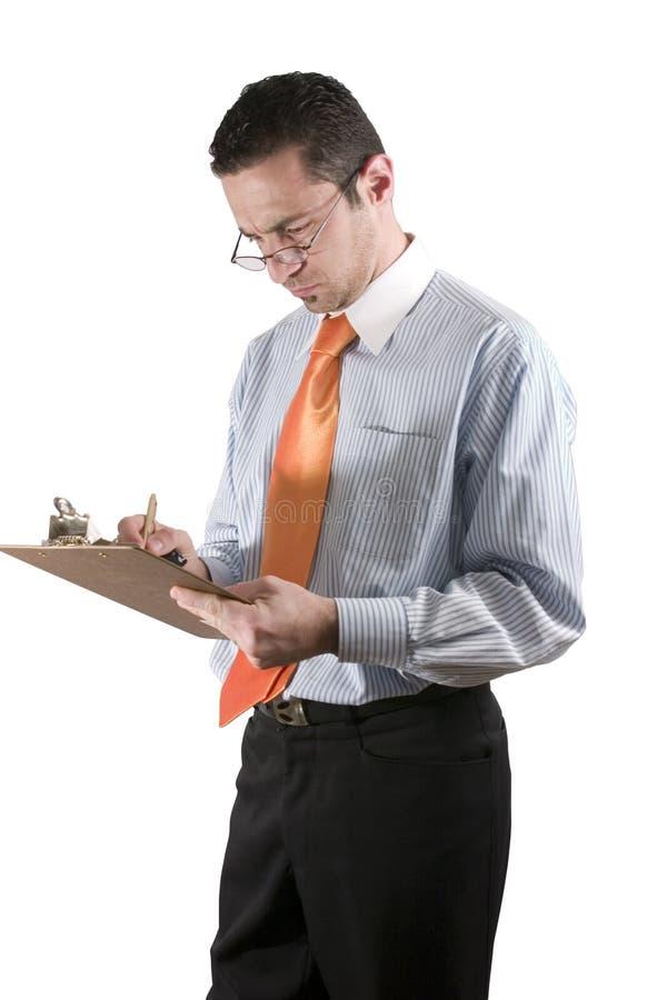 Homem de negócios com a prancheta na mão fotografia de stock
