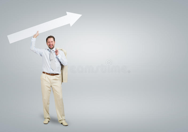 Homem de negócios com seta imagem de stock royalty free