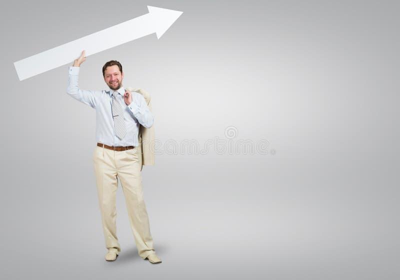 Homem de negócios com seta imagens de stock