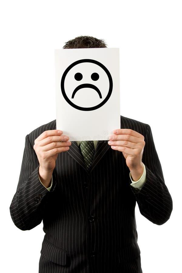 Homem de negócios com smilie triste foto de stock royalty free