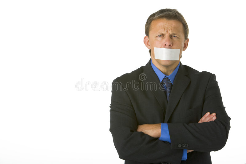 Homem de negócios com sua boca gravada fechada imagem de stock