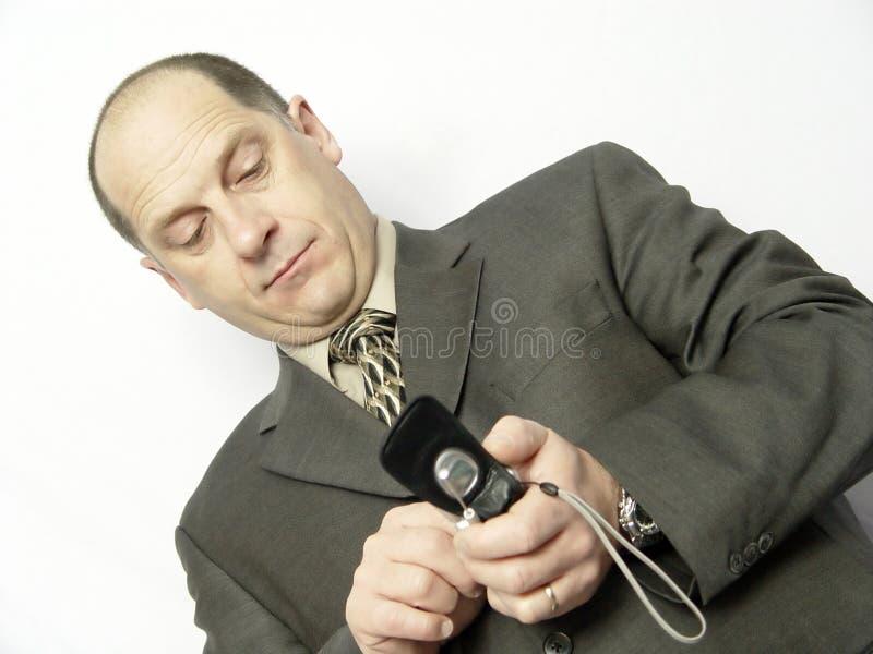 Homem de negócios com telefone imagem de stock royalty free