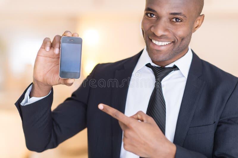 Homem de negócios com telefone celular. imagens de stock