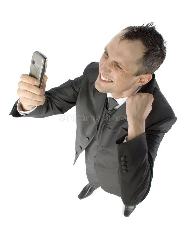 Homem de negócios com telefone de pilha fotografia de stock