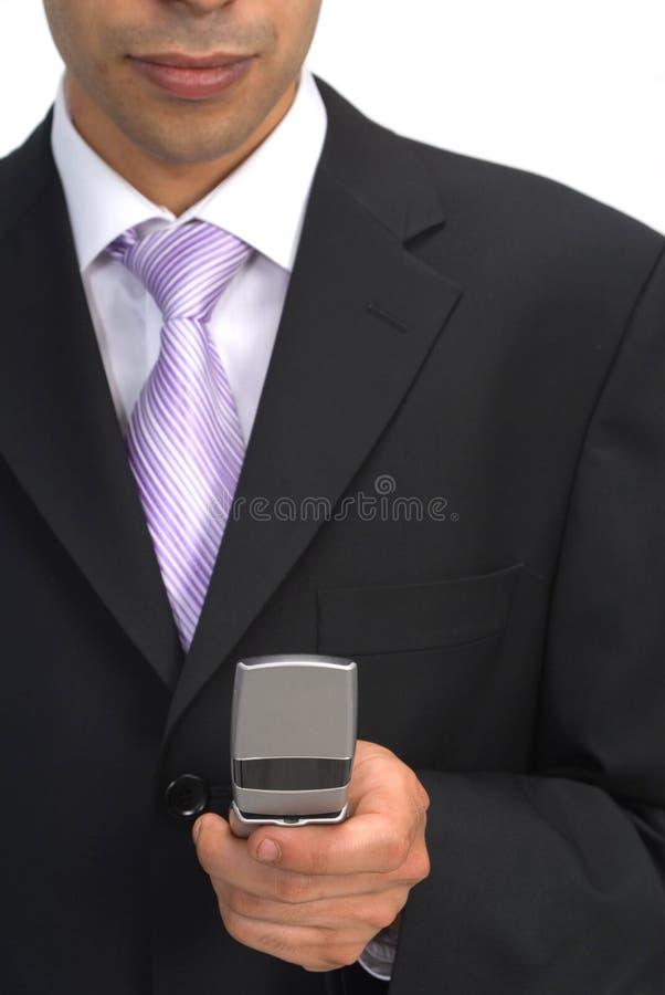 Homem de negócios com telefone de pilha imagens de stock
