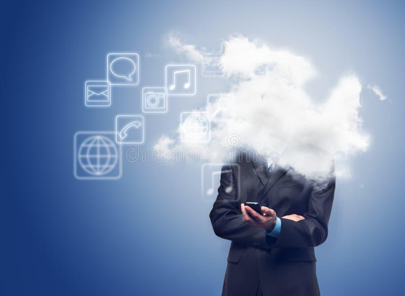 Homem de negócios com telefone e a nuvem com ícones das aplicações imagem de stock