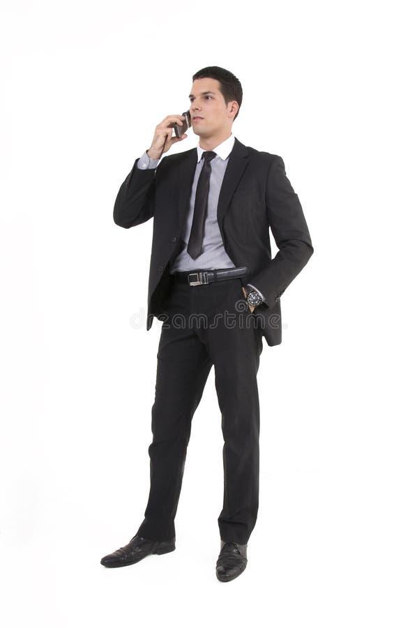 Homem de negócios com telefone e relógio imagens de stock royalty free