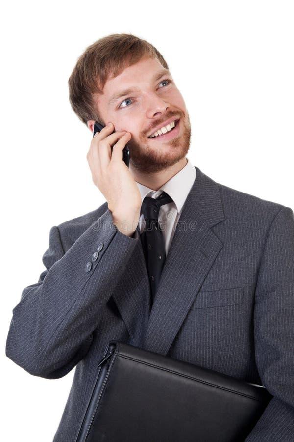 Homem de negócios com telefone esperto fotos de stock royalty free