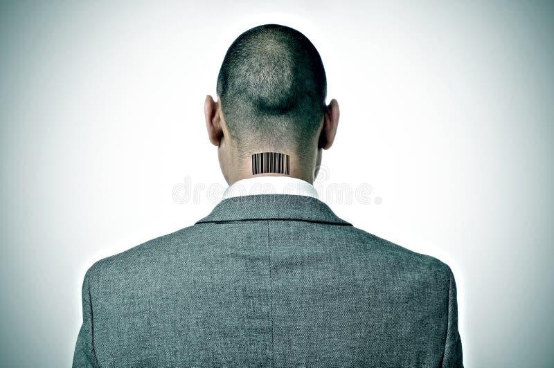 Homem de negócios com um código de barras em sua nuca fotos de stock
