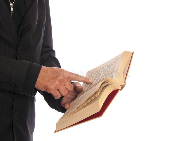 Homem de negócios com um livro em sua mão fotos de stock royalty free