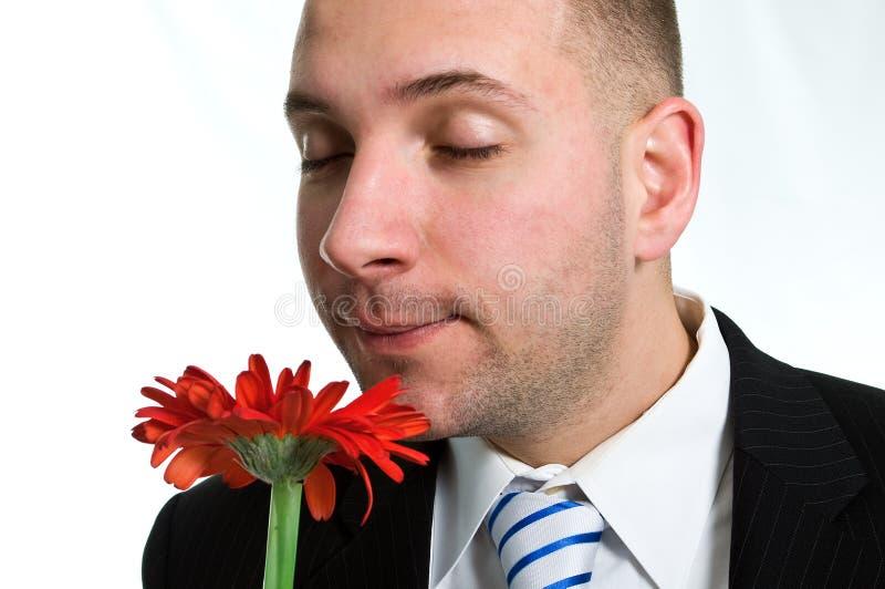 Homem de negócios com uma flor foto de stock