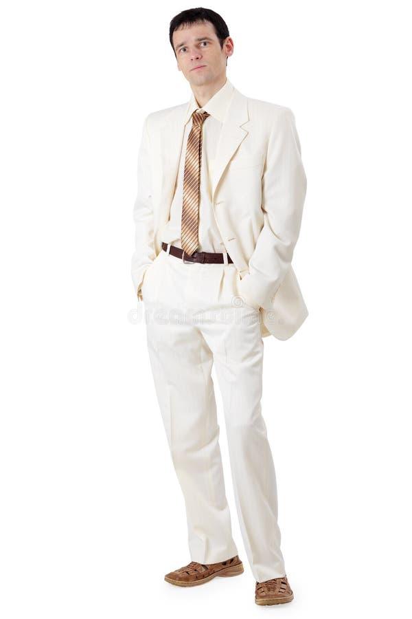 Homem de negócios considerável novo no terno branco foto de stock