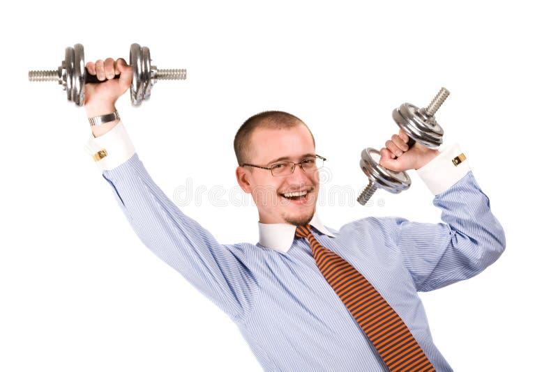 Homem de negócios considerável que exercita com dumbbells fotos de stock royalty free