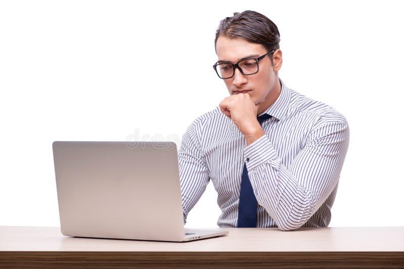 Homem de negócios considerável que trabalha com o laptop isolado no wh imagens de stock royalty free