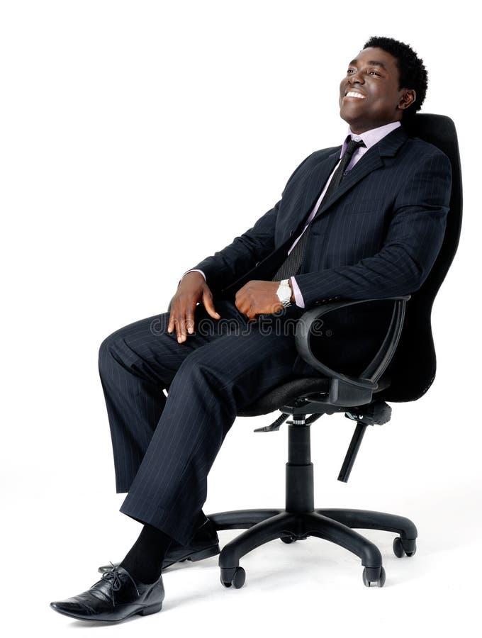 Homem de negócios da cadeira do escritório fotografia de stock