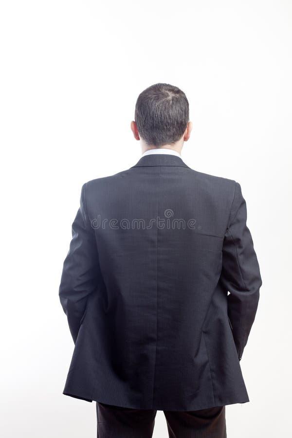Homem de negócios da parte traseira fotografia de stock