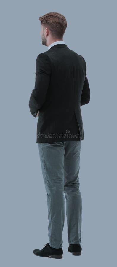 Homem de negócios da parte traseira - olhando algo sobre vagabundos brancos imagens de stock